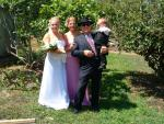 My older sis Marisa on her wedding day accompanied by her son, Alister, Dad and Angelina